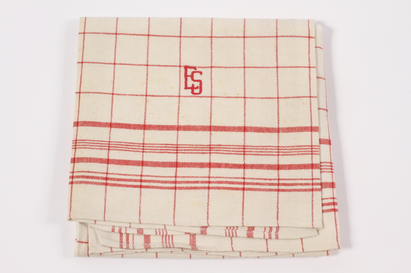 2012.485.4 front Red checked towel embroidered ES saved by German Jewish refugees