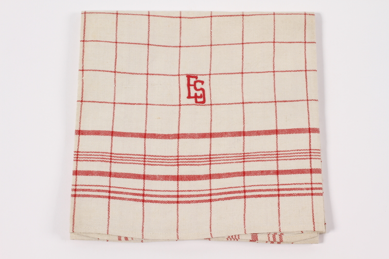 2012.485.5 front Red checked towel embroidered ES saved by German Jewish refugees