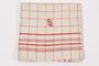 Red checked towel embroidered ES saved by German Jewish refugees