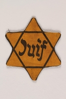 1992.19.1 front Star of David badge with Juif printed in the center  Click to enlarge