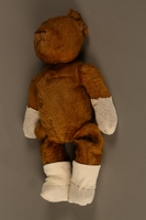 2013.104.2 left side Much loved teddy bear given to a Hungarian Jewish girl after her return from Theresienstadt  Click to enlarge