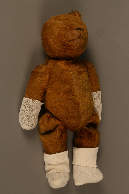 2013.104.2 right side Much loved teddy bear given to a Hungarian Jewish girl after her return from Theresienstadt
