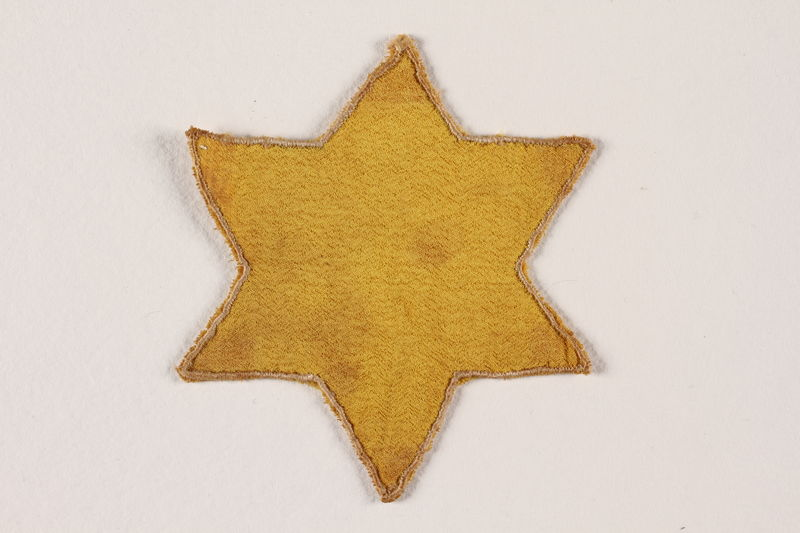 1992.19.2 front Star of David badge