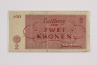 2012.409.10 back Theresienstadt ghetto-labor camp scrip, 2 kronen note acquired by a Hungarian Jewish youth and former concentration camp inmate  Click to enlarge