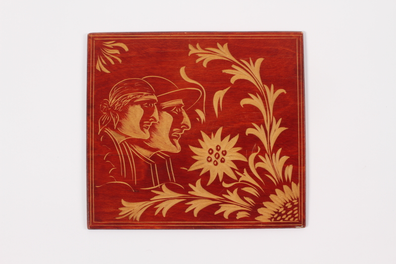 2014.498.2 a front Wooden cover with an engraved image of a couple