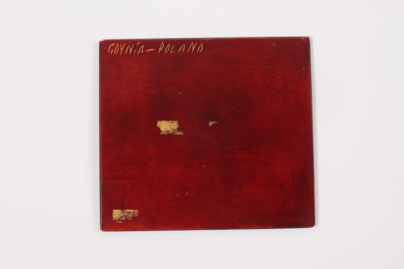 2014.498.2 b front Wooden cover with an engraved image of a couple