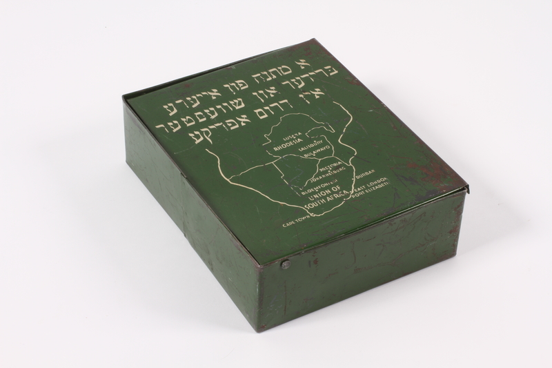 2014.498.4 front Green metal box with a map of South Africa received by a girl in a Jewish orphanage