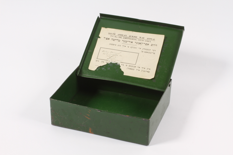 2014.498.4 open Green metal box with a map of South Africa received by a girl in a Jewish orphanage