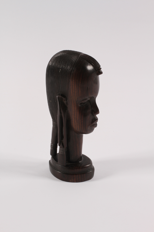 1989.306.13 right Kenyan wood bust of an African youth owned by a German Jewish refugee family