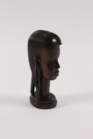 1989.306.13 right Kenyan wood bust of an African youth owned by a German Jewish refugee family  Click to enlarge