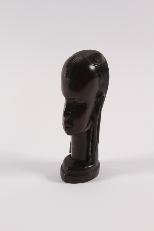 1989.306.13 left Kenyan wood bust of an African youth owned by a German Jewish refugee family