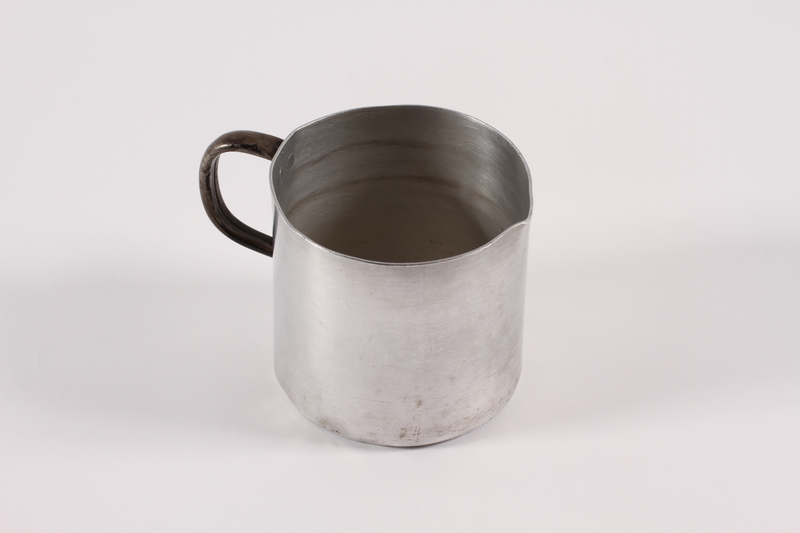 1989.306.15 right Aluminum pitcher used by a German Jewish family forced to emigrate