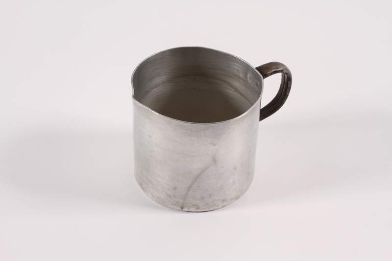 1989.306.15 left Aluminum pitcher used by a German Jewish family forced to emigrate