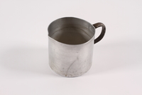 1989.306.15 left Aluminum pitcher used by a German Jewish family forced to emigrate  Click to enlarge