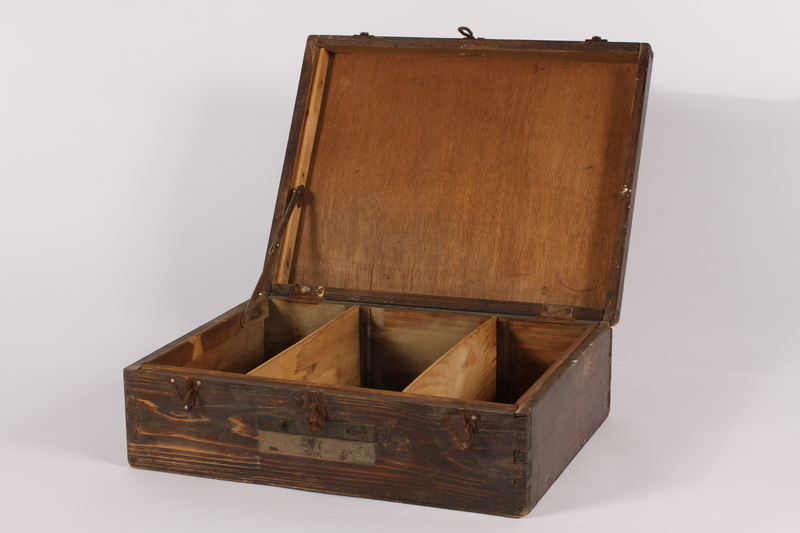 2014.463.2 open Wooden box used by a US soldier assigned to photograph the Nuremberg War Crimes Trials