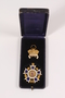 Cross and crown medal with case awarded to an Austrian Jewish family for superior dairy products