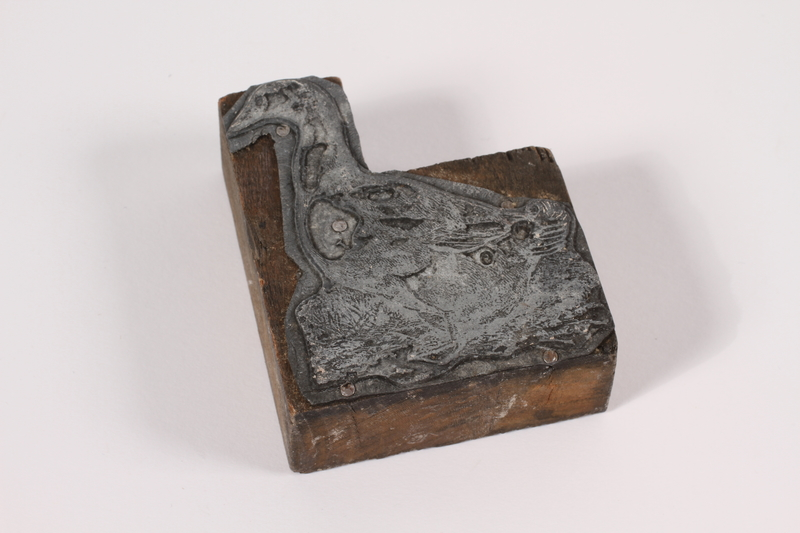 2014.520.5 front Metal and wood stamp witth an image of a goose used by an Austrian Jewish family who fled to Palestine