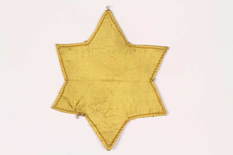 2015.472.1 front Star of David badge