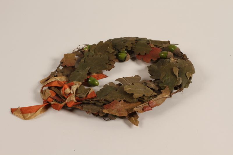 2012.444.2 a front Oak leaf wreath separated into sections awarded prewar to a Jewish youth for swimming across the Rhine River