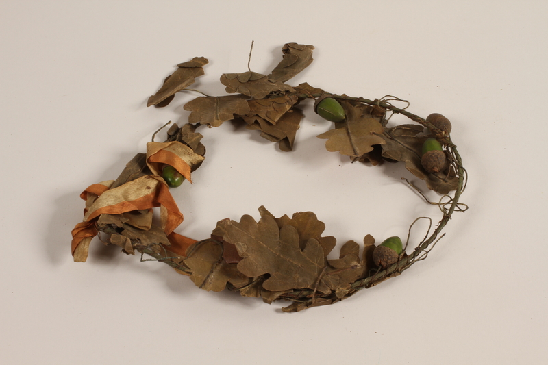 2012.444.2 b front Oak leaf wreath separated into sections awarded prewar to a Jewish youth for swimming across the Rhine River