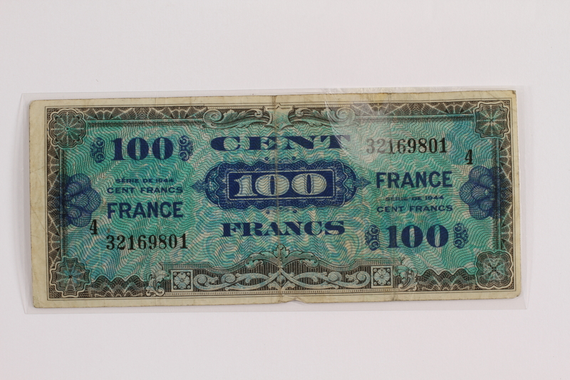 2012.409.12 front Allied Military currency for France, 100 franc bank note owned by a Hungarian Jewish concentration camp inmate