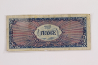 2012.409.12 back Allied Military currency for France, 100 franc bank note owned by a Hungarian Jewish concentration camp inmate  Click to enlarge