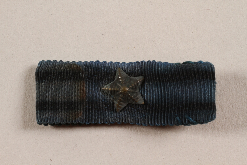 2012.471.22 front Virtuti Militari - Wound Badge ribbon with star awarded to a Jewish soldier, 2nd Polish Corps