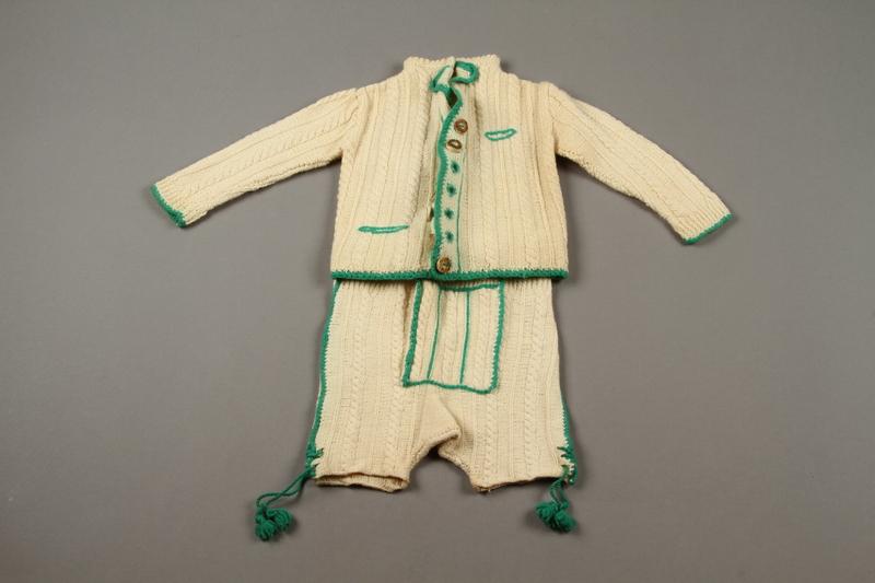 2018.126.21a-b front Child's lederhosen and cardigan sweater set