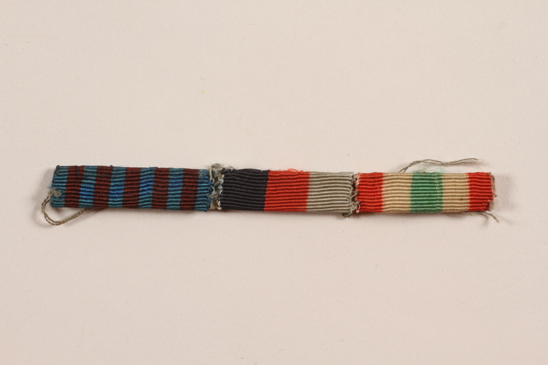 2012.471.24 front Riband bar with three ribbons awarded to a Jewish soldier, 2nd Polish Corps