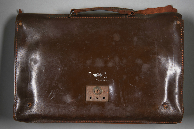 2013.117.2 back Dark brown leather briefcase brought to the US by a Jewish Hungarian refugee