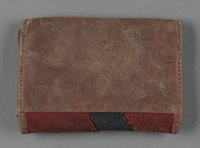2013.117.4 back Patchwork leather wallet brought to the US by a Jewish Hungarian refugee  Click to enlarge