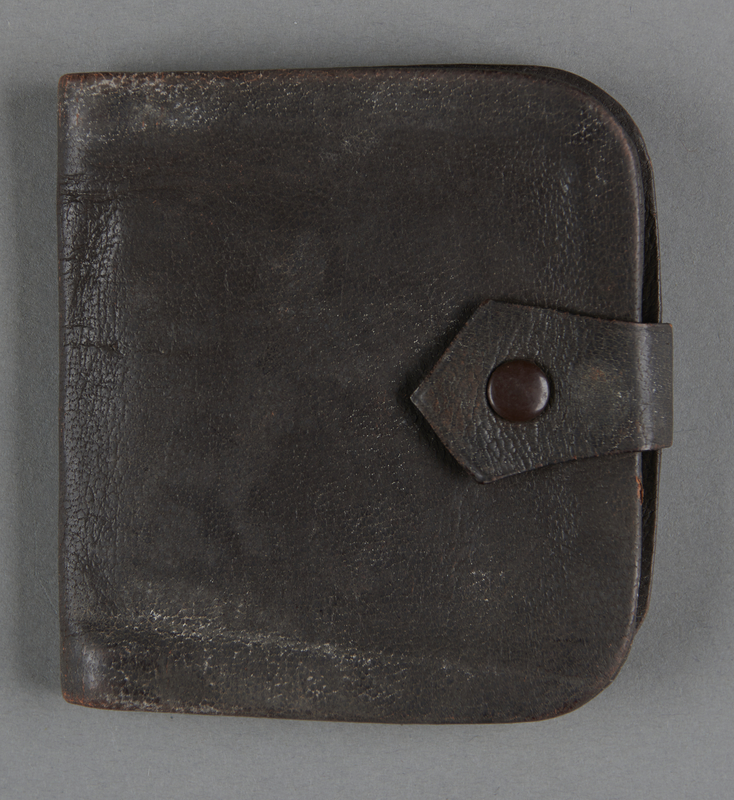 2013.117.5 front Brown leather wallet with a strap brought to the US by a Jewish Hungarian refugee