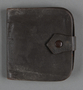 Brown leather wallet with a strap brought to the US by a Jewish Hungarian refugee