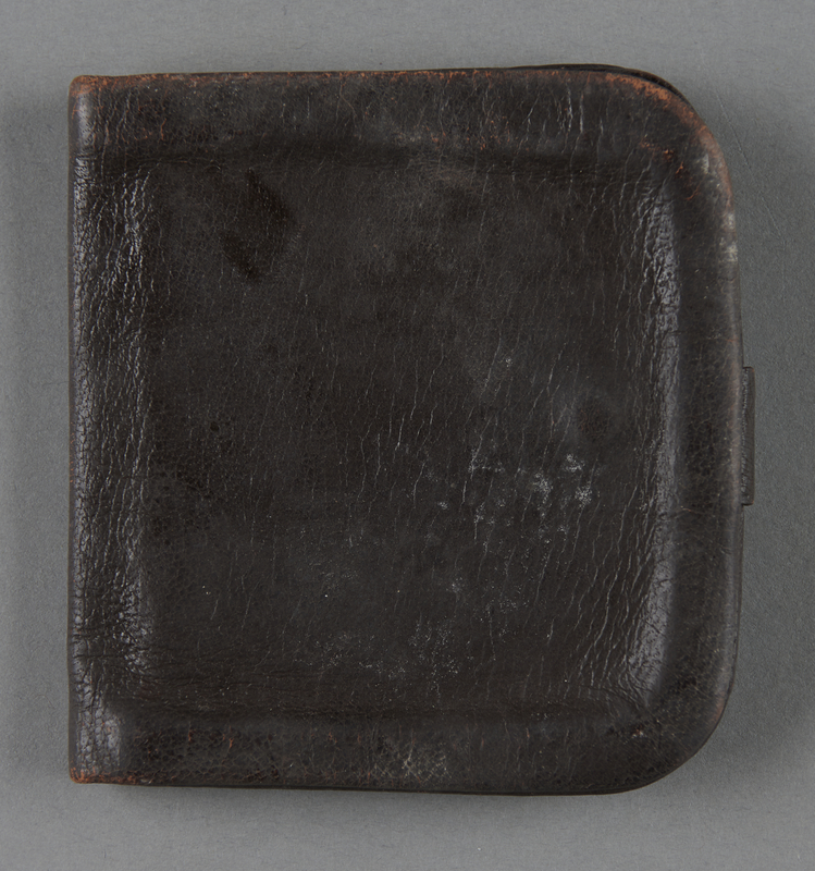 2013.117.5 back Brown leather wallet with a strap brought to the US by a Jewish Hungarian refugee