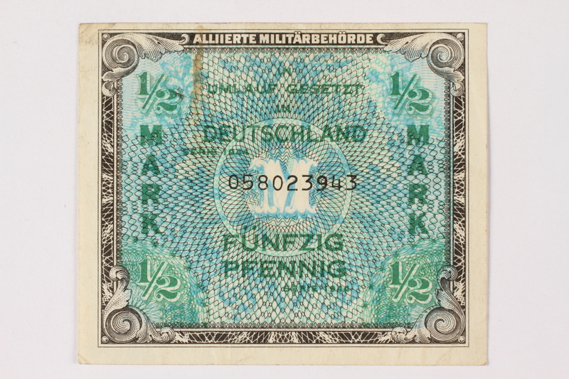 2006.473.8 front Allied Military Authority currency, German ½ mark, acquired by a female forced laborer