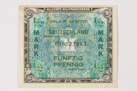 2006.473.8 front Allied Military Authority currency, German ½ mark, acquired by a female forced laborer  Click to enlarge
