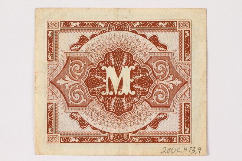 2006.473.9 back Allied Military Authority currency, German 1 mark, acquired by a female forced laborer