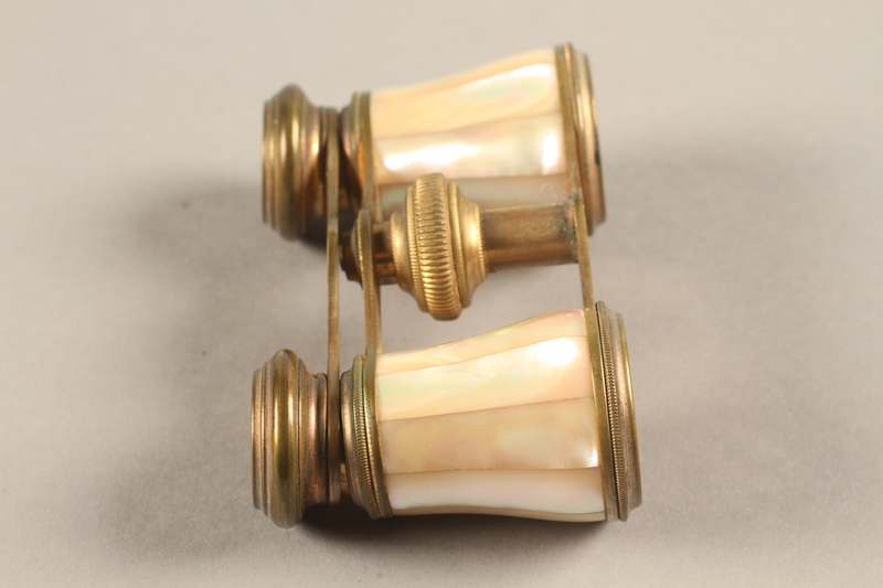 2018.258.2 a-b right Opera glasses and case owned by a Jewish Austrian refugee