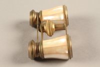 2018.258.2 a-b right Opera glasses and case owned by a Jewish Austrian refugee  Click to enlarge