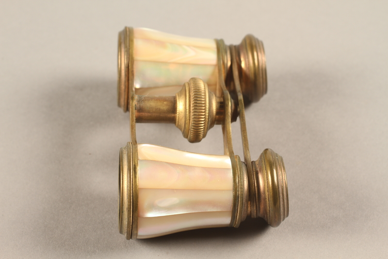 2018.258.2 a-b left Opera glasses and case owned by a Jewish Austrian refugee