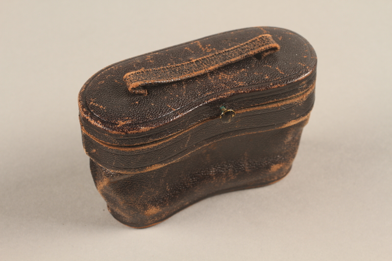 2018.258.2 c 3/4 view closed Opera glasses and case owned by a Jewish Austrian refugee