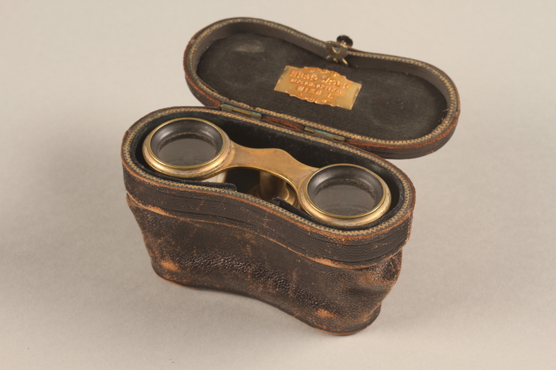 2018.258.2 a-c 3/4 view open Opera glasses and case owned by a Jewish Austrian refugee