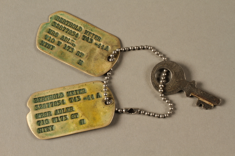 2018.204.2 front Set of US Army issue dog tags and a key on a chain belonging to a German Jewish refugee and soldier