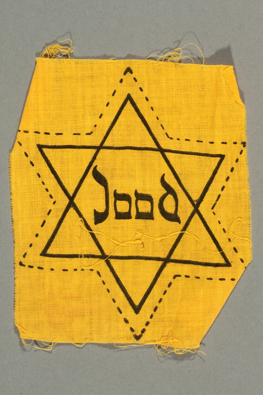 2018.229.3 front Uncut factory-printed Star of David badge acquired by a Jewish person in the Netherlands