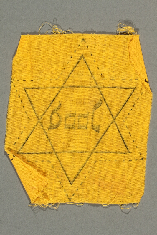 2018.229.3 back Uncut factory-printed Star of David badge acquired by a Jewish person in the Netherlands