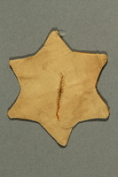 2016.552.2 back Factory-printed Star of David badge printed with Jude, belonging to a German Jewish woman  Click to enlarge
