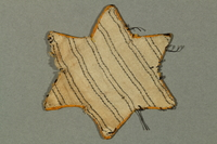 2016.552.3 back Factory-printed Star of David badge printed with Jude, belonging to a German Jewish woman  Click to enlarge