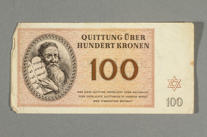 2016.552.35 front Theresienstadt ghetto-labor camp scrip, 100 kronen note, belonging to a German Jewish woman