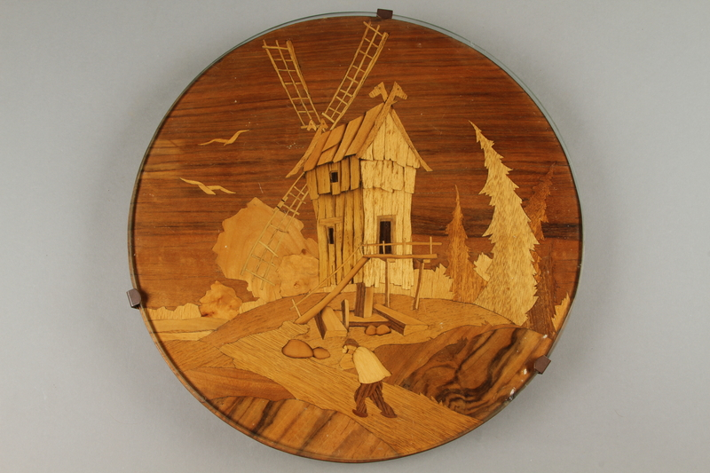 2018.276.1 front Wooden Lazy Susan decorated with an inlaid windmill scene created by a Jewish Latvian in a displaced persons camp