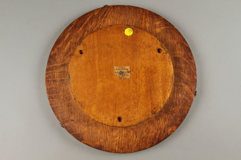 2018.276.1 back Wooden Lazy Susan decorated with an inlaid windmill scene created by a Jewish Latvian in a displaced persons camp